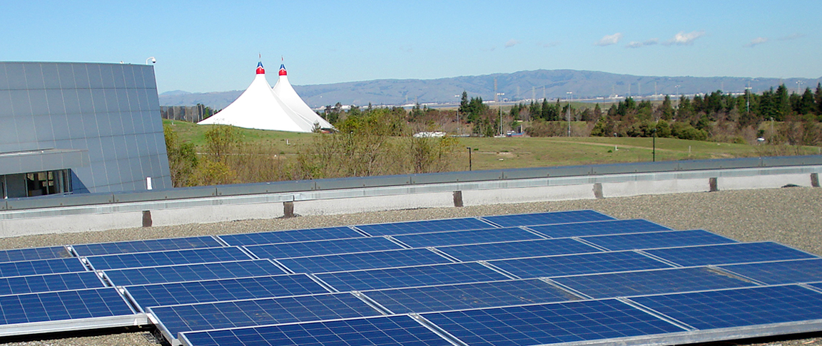 Overview of the rooftop solar PV system installation with the iconic Shoreline Amphitheatre tent sails in the background